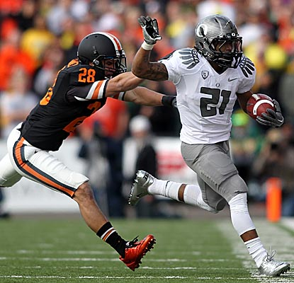 LaMichael James (right) and Kenjon Barner combine for 267 yards rushing and three TDs to help carry Oregon to victory. (Getty Images)