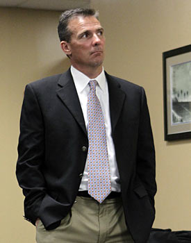 Urban Meyer, can you please gently slide out the back door so Will Muschamp has room to breathe? (AP)