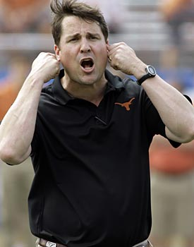 Before taking the head job at Florida, Will Muschamp made over $900,000 as an assistant at Texas. (AP)