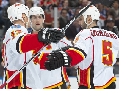 Mark Giordano (right) celebrates his goal in the second period with teammates.  (US Presswire)