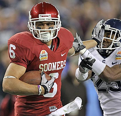 Cameron Kenney and the No. 9 Sooners keep the Big East champion Huskies at arm's length. (Getty Images)