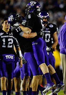 TCU players celebrate on the sidelines at the Rose Bowl after handing Wisconsin a 21-19 loss. (Getty Images)