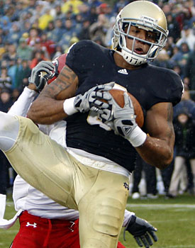 Michael Floyd gave Notre Dame its biggest offseason bump when he passed on the NFL. (US Presswire)