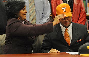 The hat doesn't always fit the same for proud parents and prized recruits. (AP)