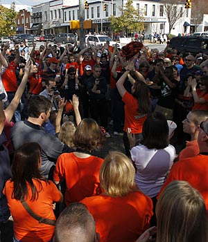 Auburn fans gather to commemorate the historic trees that were allegedly poisoned by an Alabama fan. (AP)