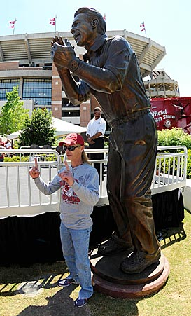 For Alabama fans, the theme of the day seems to be: Show up for the statue, stay for the game. (US Presswire)