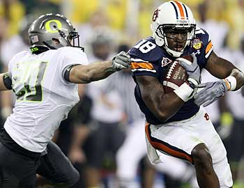 Both participants in the last BCS title game, Oregon and Auburn, are being investigated by the NCAA. (Getty Images)