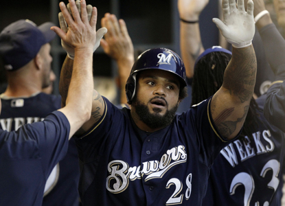 Prince Fielder (center) celebrates his two-run HR in the sixth inning, giving him an NL-best 67 RBI.  (Getty Images)