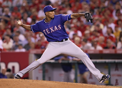 Alexi Ogando hurls eight spectacular innings of four pitch ball to help the Rangers up their win streak to 12 games.  (Getty Images)