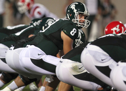Michigan State QB Kirk Cousins goes 18 for 22 with 222 yards and a passing TD against Youngstown State.  (Getty Images)