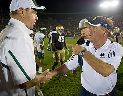 South Florida's Skip Holtz and Notre Dame's Brian Kelly exchange words following the Bulls' 23-20 win. (US Presswire)
