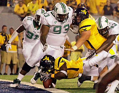 West Virginia's Vernard Roberts (bottom) scores a touchdown against the Marshall during the fourth quarter. (US Presswire)