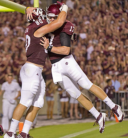 Texas A&M's Hudson Prioleau (left) celebrates with QB Ryan Tannehill after a third-quarter touchdown. (AP)