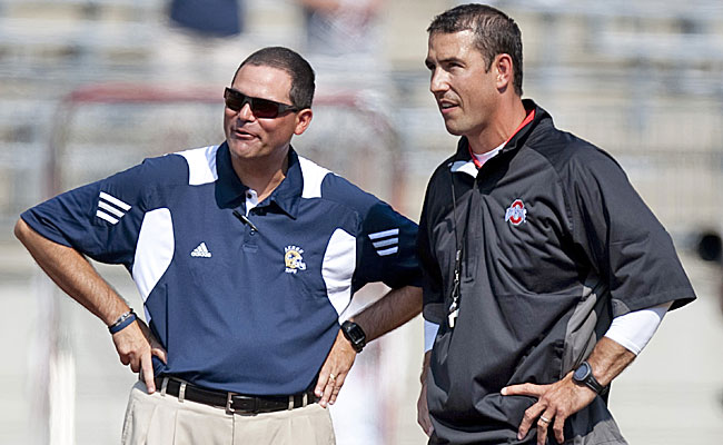 Akron's Rob Ianello and Ohio State's Luke Fickell chat. After the game, Ianello was unhappy. (US Presswire)