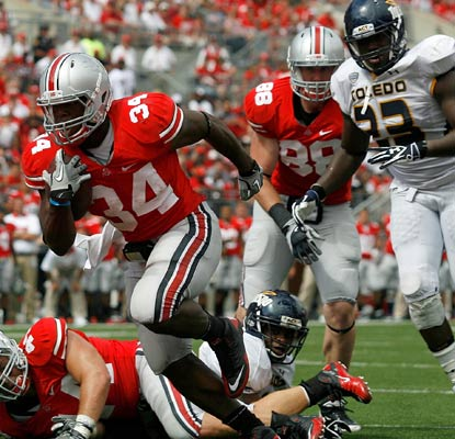 Ohio State's Carlos Hyde scores the decisive touchdown late in the third quarter against Toledo.  (Getty Images)