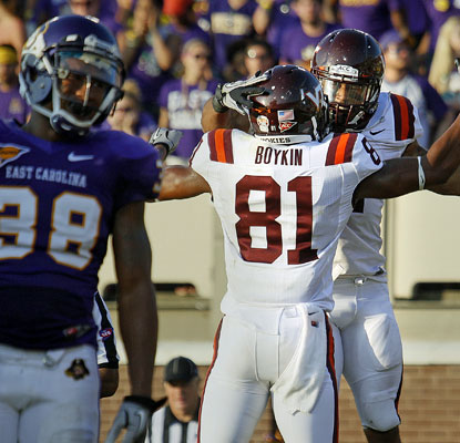 Josh Oglesby celebrates his go-ahead touchdown run as the Hokies stave off a stiff challenge from East Carolina.   (AP)