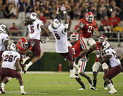 South Carolina's Melvin Ingram (6) recovers an onside kick by Georgia during the fourth quarter to help seal the win. (US Presswire)