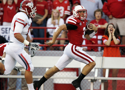 Cornhusker QB Taylor Martinez (right) throws for 219 yards and runs for 166 more before finishing with three TD's.  (Getty Images)