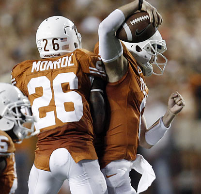 Backup QB Case McCoy (right) celebrates with RB D.J. Monroe as each play key roles in Texas' fourth-quarter comeback.  (AP)