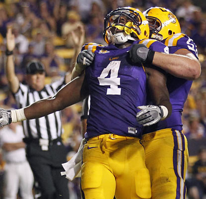 LSU running back Alfred Blue rejoices after he scores a 4-yard touchdown run in the third quarter.  (AP)