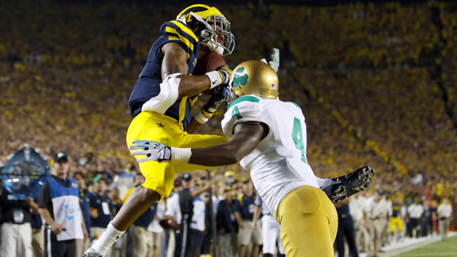 Wolverines wide receiver Roy Roundtree catches the game-winning TD late in the fourth quarter. (US Presswire)