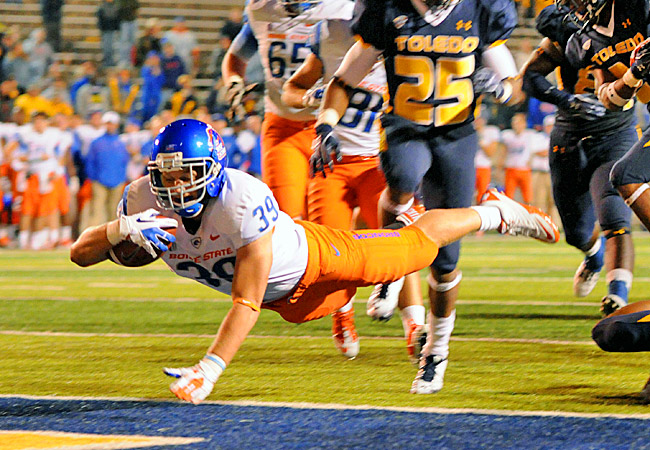 Boise State running back Drew Wright scores a touchdown against Toledo in the second half. (US Presswire)