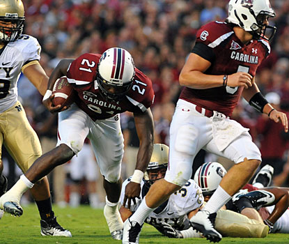 Marcus Lattimore (21) rumbles for a career-high 246 yards on 37 carries to put up three touchdowns. (Getty Images)