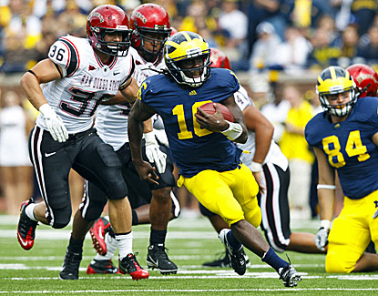 Michigan's Denard Robinson runs for extra yardage against San Diego State. Robinson scores three touchdowns in the win. (US Presswire)