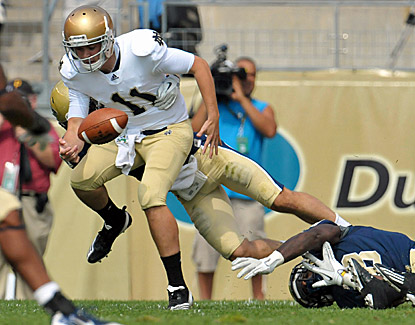 Tommy Rees is hit by a Pitt defender and loses the ball in Notre Dame's 15-12 win over the Panthers. (US Presswire)