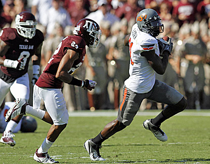 Oklahoma State's Justin Blackmon makes 11 receptions for 121 yards in the Cowboys' road win. (US Presswire)