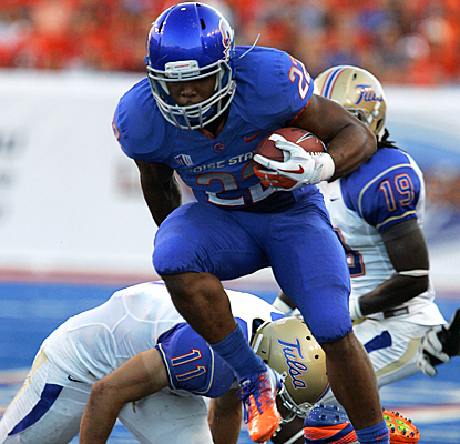 Boise State's Doug Martin rushes over Tulsa's defense for 75 yards and a touchdown on 21 carries. (AP)
