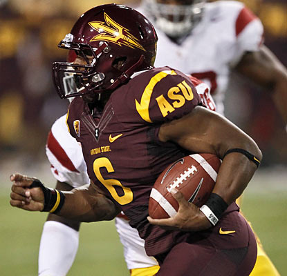 Cameron Marshall rumbles for 141 yards and scores three times as the Sun Devils smack down the No. 23 Trojans.  (AP)