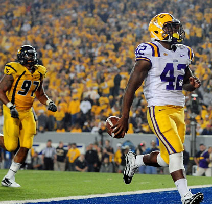 LSU's Michael Ford leaves West Virginia behind with two rushing touchdowns in the Tigers' impressive win.  (US Presswire)