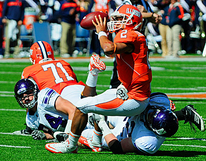 Illinois quarterback Nathan Scheelhaase tries to avoid being sacked. His score with 13 seconds left lifts Illinois to a win. (US Presswire)