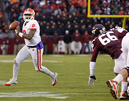 Tajh Boyd looks to pass as Virginia Tech's Tyrel Wilson (66) chases. Boyd passes for a score and 204 yards in the Tigers' win. (US Presswire)