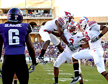 Darius Johnson (3) celebrates with teammates after catching a touchdown pass during SMU's 40-33 in overtime. (US Presswire)