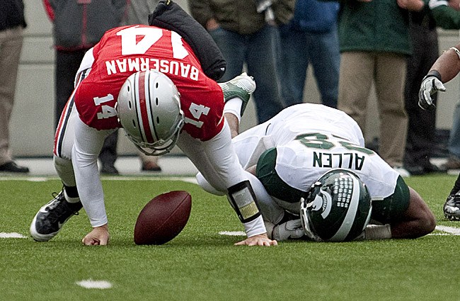 Joe Bauserman (14) scrambles after his own fumble caused by Michigan State's Denicos Allen. (US Presswire)