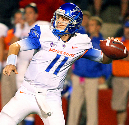Boise State's Kellen Moore drops back for a pass during the first quarter against Fresno State. (AP)