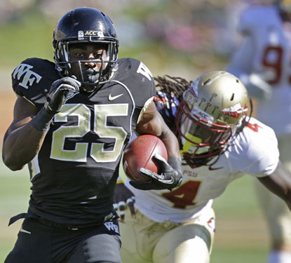 Josh Harris gouges the ACC's top run defense for gains of 42 and 57 yards to set up Wake Forest touchdowns.  (AP)