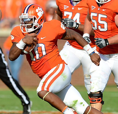 Clemson QB Tajh Boyd rushes for a touchdown and throws for another before leaving the game with a hip injury.  (AP)
