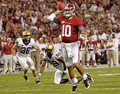 AJ McCarron passes for 237 yards and four touchdowns, including one here in the first half against Vanderbilt. (AP)