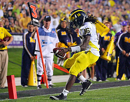 Michigan's Denard Robinson scores one of his four touchdowns, this one in the second half. (US Presswire)