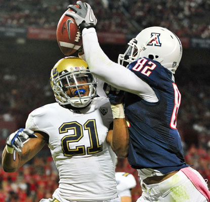 Arizona's Juron Criner steals the ball away from UCLA's Aaron Hester for his second touchdown of the game.  (US Presswire)