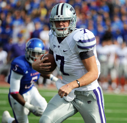 Collin Klein throws for a career-high 195 yards and runs for another 92 yards. He ends the game with five total touchdowns.  (US Presswire)