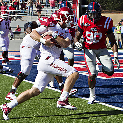 Arkansas' Tyler Wilson steps into the end zone. The Hogs' QB scores two rushing TDs.  (Getty Images)