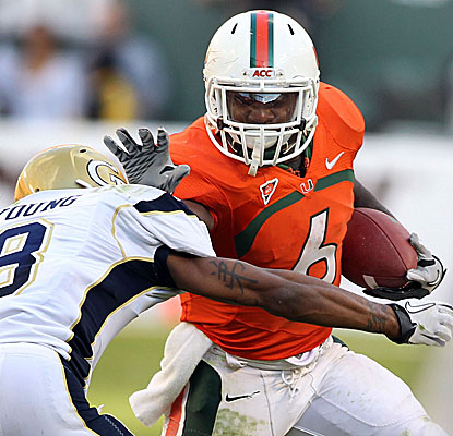 Lamar Miller tallies 93 rushing yards and a touchdown as the Hurricanes pour it on vs. the Yellow Jackets. (US Presswire)