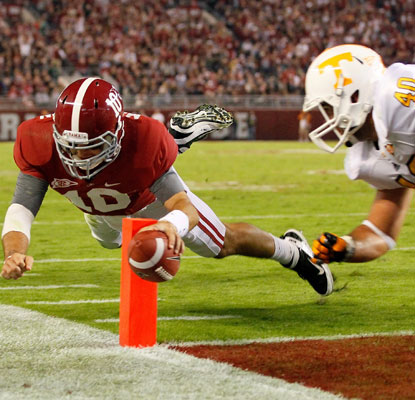 AJ McCarron dives for his one rushing touchdown and adds another through the air to keep Alabama on track for LSU.  (Getty Images)