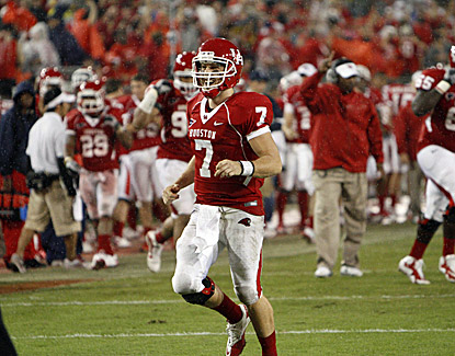 Houston's Case Keenum celebrates after throwing his record ninth touchdown pass in the Cougars' 73-34 win over Rice. (US Presswire)