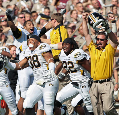 Missouri's sideline erupts after clinching an overtime win against the No. 16 Aggies in College Station.  (US Presswire)