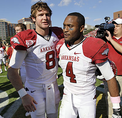 Tyler Wilson and Jarius Wright celebrate after helping dig Arkansas out of a two-touchdown hole at Vanderbilt.  (AP)